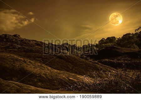 Landscape of sky with cloud and beautiful full moon. Outdoor at nighttime. Vintage and sepia tone. The moon taken with my own camera.