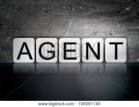 The word Agent concept and theme written in 3D white tiles on a dark background.