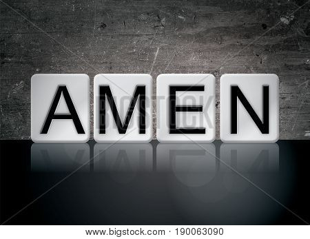 The word Amen concept and theme written in 3D white tiles on a dark background.