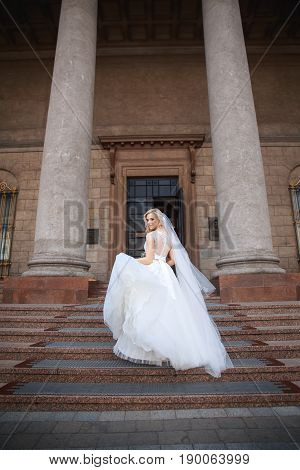 Beautiful bride outdoors. Beautiful bride with bouquet of flowers outdoor . Beautiful bride posing in her wedding day