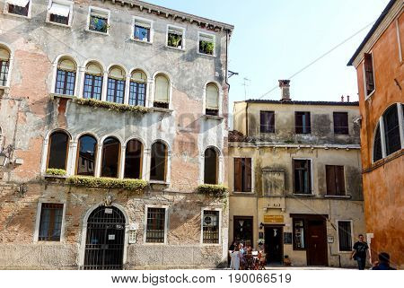 VENICE, ITALY - May 18, 2017.street view of old buildings in Venice on May 18, 2017. its entirety is listed as a World Heritage Site, along with its lagoon