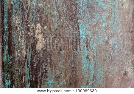 Oxidized metal weathered textured patina background closeup