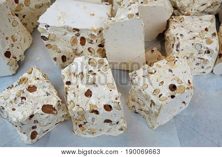 Italian torrone traditional candy confectionery with almonds