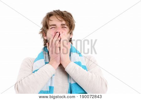 Guy in striped blue towel with sleepy face expression yawning and covering his mouth with hands isolated on white background. Good morning concept