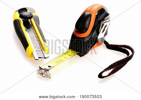 Tape Measure And Utility Knife Isolated On White Background