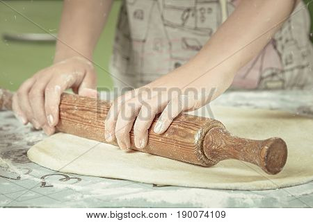 Female Hands In Flour Kneading Dough On Table