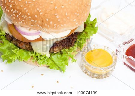 Lentil Burger Preparation : Lentils cheeseburger on white background