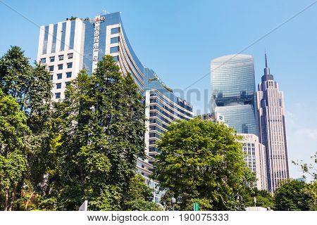 Green Trees And Modern Buildings In Guangzhou