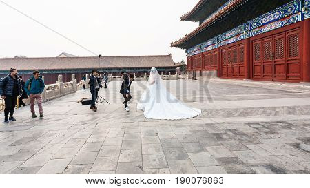 Bride In Photosession At Courtyard Of Temple