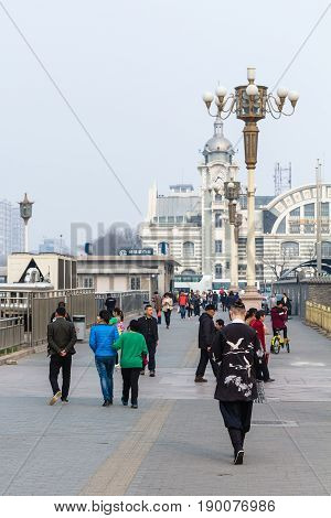 Tourists Walk To Zhengyangmen East Railway Station