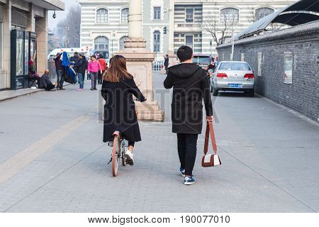 People Walk To Zhengyangmen East Railway Station