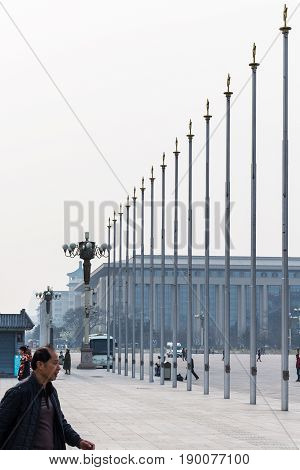 Tourists Near Flagpoles On Tiananmen Square