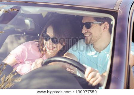 Travel. Couple is traveling in the car