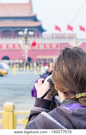 Tourist Photographs The Tiananmen Monument