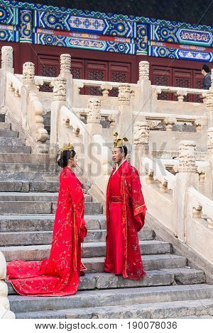 Couple In Traditional Dresses On Steps Of Temple