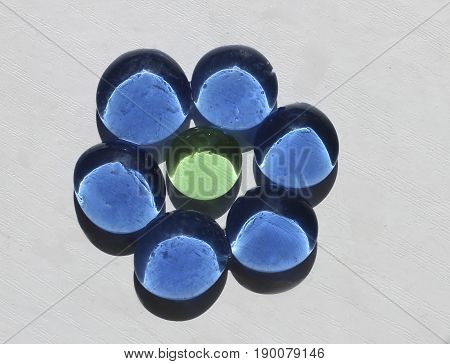 glass beads, blue glass flower on a white background