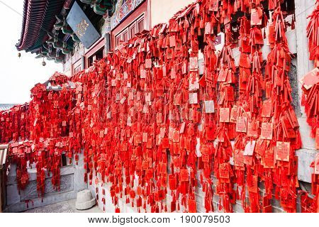 Red Signs On Temple On East Hill In Longmen