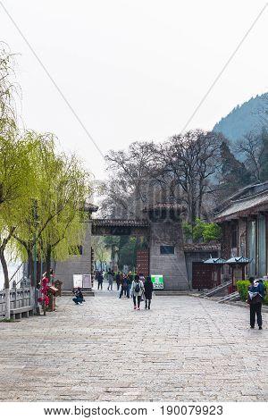 Tourists Walk To Longmen Grottoes