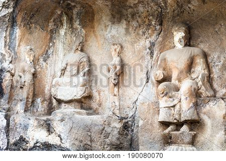 Carved Statues In Cave Of Longmen Grottoes