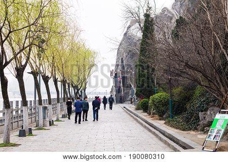 Visitors On Embankment Of Yi River In Longmen