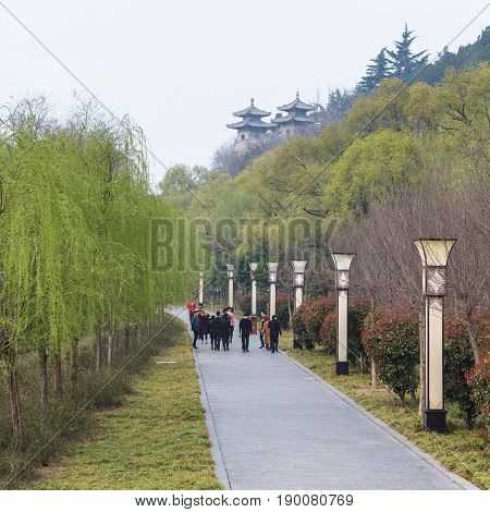 Tourists Walk To Temples In Longmen Grottoes