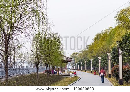 Tourists On Embankment Of Yi River On East Hill