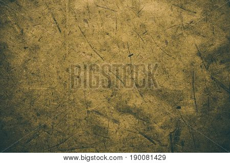 Yellow rough vintage paper. Abstract background and texture for designers. Old vintage recycled paper. Dark rough vintage paper background. Yellow rough paper in vintage style.