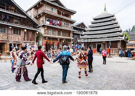 Visitors In Round Dance On Square In Chengyang