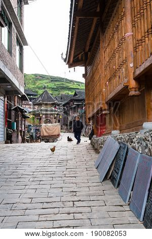 Woman On Alley In Chengyang Village