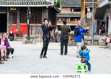 Tourists Take Photos Of Dong Culture Show