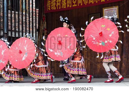 Folk Dancers With Umbrellas In Dong Culture Show