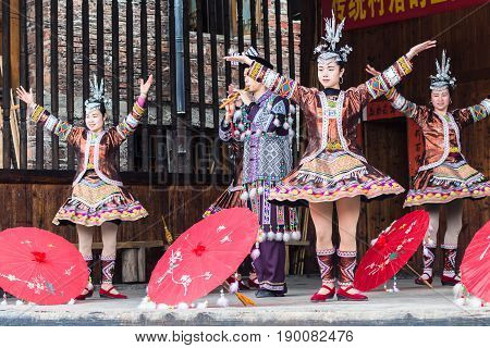 Folk Players With Umbrellas In Dong Culture Show