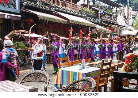 Folk Musicians On West Street In Yangshuo City
