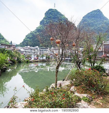 Tree With Lanterns On Waterfront In Yangshuo Town