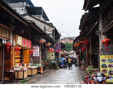 Visitors On Eatery Street In Xingping Town