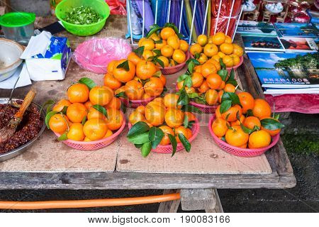 Mandarines On Stall In Market In Xingping Town