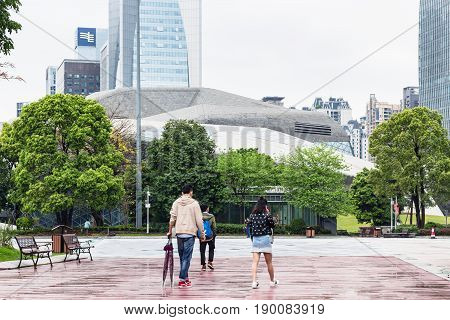 People On Square Near Opera House In Rainy Day