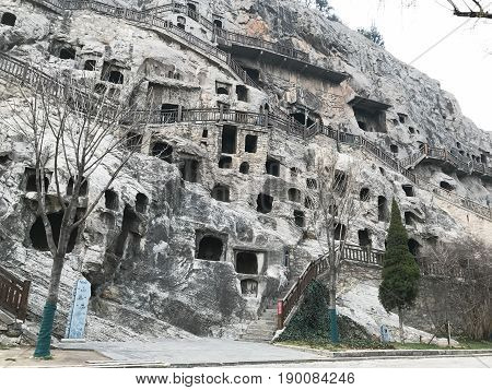 Carved Caves And Houses In Longmen Grottoes