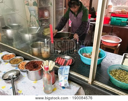 Chief Cooks Food In Cheap Urban Eatery