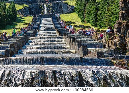 KASSEL, GERMANY-JUNE 18, 2014: The Hercules Monument and water running down the cascades during the water features in the Bergpark of the Wilhelmshoehe Palace, Germany