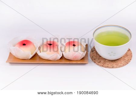 Japanese Traditional Sweets (Wagashi) with green tea  on white background,made of mochi, anko, and fruits,Wagashi are typically made from plant ingredients.