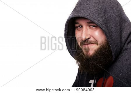 Close portrait of a guy with a beard and mustache in kapyushone.Emu very fun constrains smile. Isolated on white background