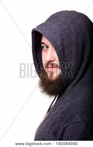 A man with a big beard in the hood. Isolated on white background.