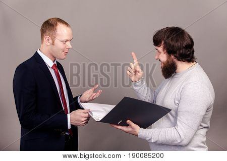 Business negotiations. Salesman and buyer discuss the contract standing in front of each other isolate on dark background.