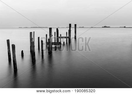 Long Exposure of Wood Pier Pilings in B&W