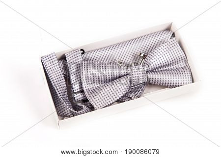 bow tie and cufflinks. the preparations of the groom and details of the wedding day isolate on white background.