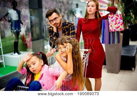 A family of four is tired after shopping