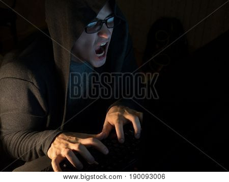 Computer hacker man stealing information with laptop.