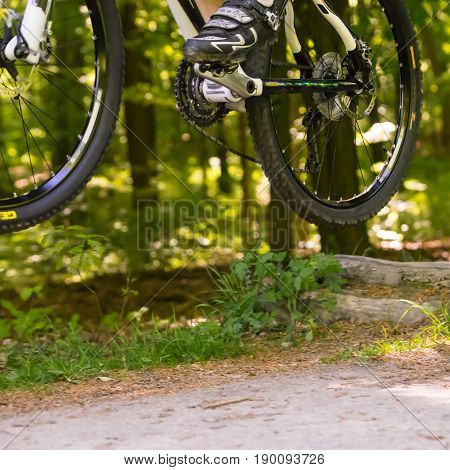 Mountainbiker jumping with bike cross the country