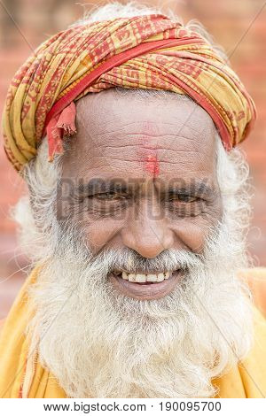 KATHMANDU NEPAL - SEPTEMBER 29 2016 : Portrait of Shaiva sadhu holy man in Pashupatinath Temple . Close up
